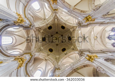 BRUSSELS, BELGIUM - 11 AUGUST, 2015: Inside famous Our Lady of Assistance Church, showing beautiful white ceiling with golden decorative details. - stock photo