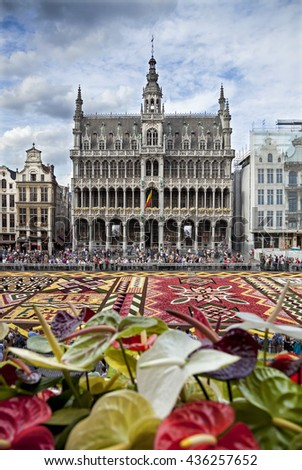 BRUSSELS, BELGIUM - AUGUST 16, 2012: King House building during Flower Carpet Festival. This biannual event takes place at the Grand Place, and this year design of the carpet was in honor of Africa. - stock photo
