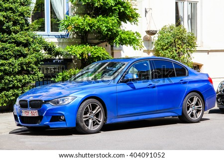 BRUSSELS, BELGIUM - AUGUST 9, 2014: Motor car BMW F30 3-series in the city street. - stock photo