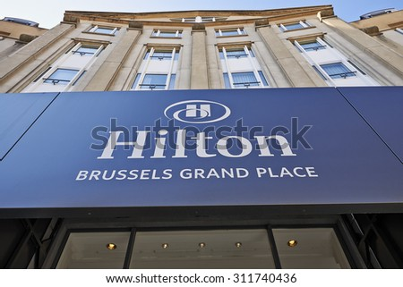 BRUSSELS,BELGIUM - 29 AUGUST 2015: The logo above the main entrance of the Hilton Hotel Grand Place in Brussels on 29 August 2015 - stock photo