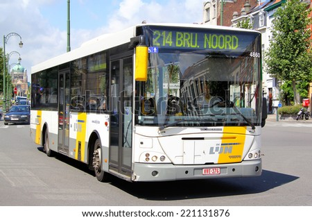 BRUSSELS, BELGIUM - AUGUST 9, 2014: White city bus VDL Jonckheere Transit at the city street. - stock photo