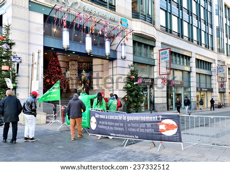 BRUSSELS, BELGIUM-DECEMBER 8, 2014: In day of National Strike usually crowded commercial street Rue Neuve is closed by strike participants - stock photo