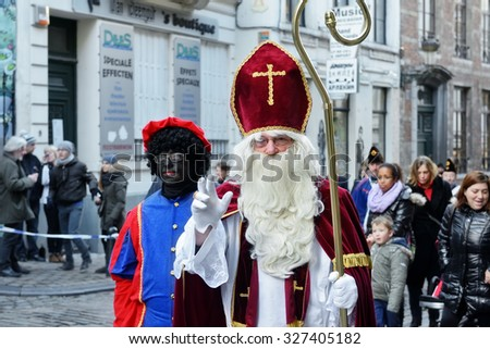 BRUSSELS, BELGIUM-DECEMBER 6, 2014: Traditional Parade of Saint Nicolas moving to Grand Place of Brussels