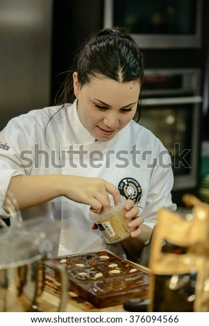 """BRUSSELS,BELGIUM,FEBRUARY 5: Chocolate show during the exhibition """"Salon du chocolat"""" on February 5, 2016 in Brussels, Belgium - stock photo"""