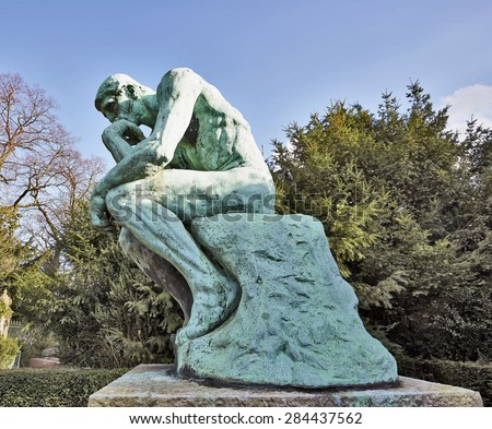 BRUSSELS, BELGIUM - FEBRUARY 16, 2014: The Thinker, bronze cast by Alexis Rudier, Laeken Cemetery, Brussels, Belgium. Rodin sculpted The Thinker in 1880. Replicas now adorn parks, museums, gardens. - stock photo