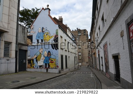BRUSSELS, BELGIUM - JULY 14: Filtered picture of a comic strip mural painting on July 14, 2014 in Brussels, Belgium. Brussels is known as a homeland of comic strips and is full of comic murals. - stock photo