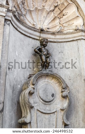 BRUSSELS, BELGIUM - JULY 6: Manneken Pis statue in Brussels. Statue of a pissing boy in a beautiful summer day in Brussels, Belgium on July 6 2014