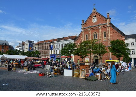 Brussels, Belgium - July 14, 2014: People shopping on a daily flea market at Place du Jeu de Balle on July 14, 2014 in Brussels, Belgium. - stock photo