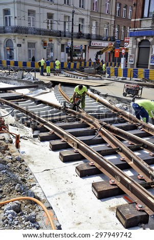 BRUSSELS, BELGIUM -16 JULY 2015: Some workers repair and replace some rail trams in Brussels at Verboekhoven square in Schaerbeek. - stock photo