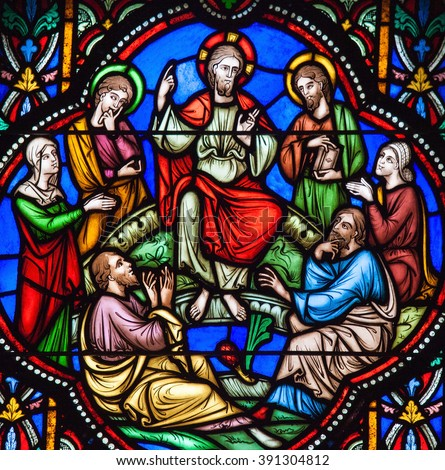BRUSSELS, BELGIUM - JULY 26, 2012: Stained glass window depicting Jesus and the Sermon on the Mount in the cathedral of Brussels, Belgium - stock photo