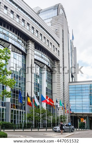 BRUSSELS, BELGIUM - JUNE 19, 2014: European Parliament offices and European flags.