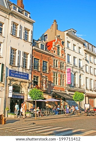 BRUSSELS, BELGIUM - JUNE 29, 2010: Place du Grand Sablon boasts antique stores, boutiques, hotels, restaurants, auction houses,  pastry shops and Belgian chocolatiers, on June 29 in Brussels. - stock photo