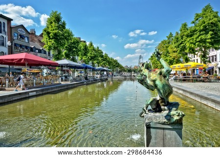 BRUSSELS, BELGIUM-JUNE 06, 2013: Place Saint Catherine, which was built on place of the old port. This square is a favorite place for tourists searching Belgian sea food restaurants - stock photo