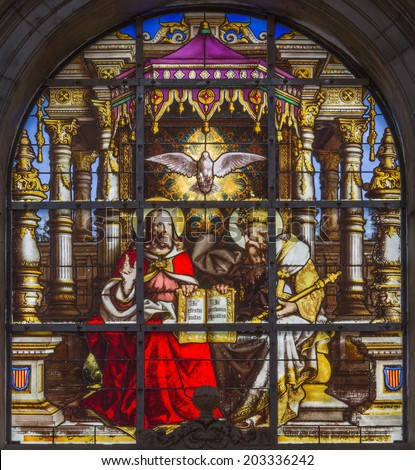 BRUSSELS, BELGIUM - JUNE 16, 2014: The Holy Trinity on windwopane from 19. cent. in the cathedral of st. Michael and st. Gudula.