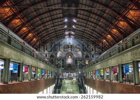 BRUSSELS, BELGIUM - MARCH 3, 2014: Interior of Central railway Station - the busiest in the country. Inside located many shops, cafes and restaurants. Two trains waiting for passengers - stock photo