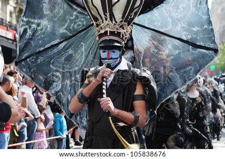 BRUSSELS, BELGIUM-MAY 19: An unknown participant plays his role in a weird composition during Zinneke Parade on May 19, 2012 in Brussels. This parade is a biennial urban artistic and free-attendance - stock photo