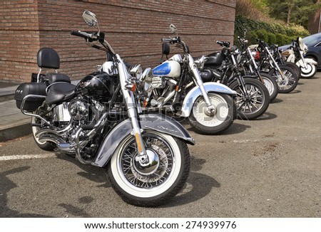 BRUSSELS, BELGIUM - May 01, 2015: Harley Davidson motorcycles lined up on the parking near the largest flea market from Brussels at Boulevard du Triomphe in Ixelles. - stock photo