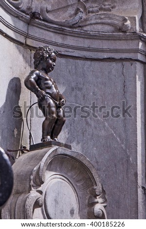 BRUSSELS, BELGIUM - MAY 19: Manneken Pis statue in Brussels. Statue of a pissing boy in a beautiful summer day in Brussels, Belgium on  May 19 2015 - stock photo