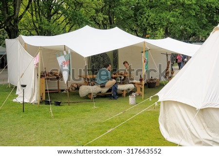 BRUSSELS, BELGIUM-MAY 19, 2013: Unidentified performers show scene from life in epoch of knights during Medieval Market celebration in Cinquantenaire Parc on May 19, 2013 in Brussels, Belgium - stock photo