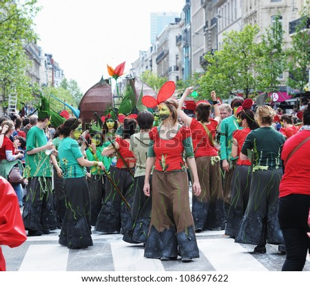 BRUSSELS, BELGIUM-MAY 19: Unknown group of participants shows creative composition during Zinneke Parade on May 19, 2012 in Brussels, Belgium. This parade is a biennial artistic free-attendance event - stock photo