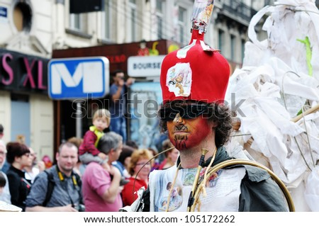 BRUSSELS, BELGIUM-MAY 19: Unknown participant demonstrates weird bright costume at Zinneke Parade on May 19, 2012 in Brussels, Belgium. This parade is an artistic biennial urban free-attendance event. - stock photo