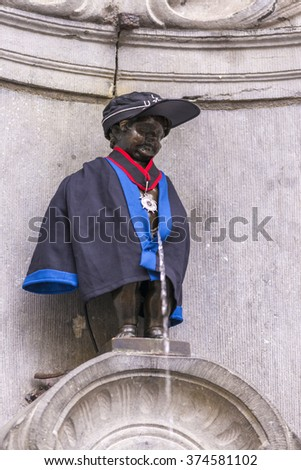 BRUSSELS, BELGIUM - November 8, 2015 : Manneken Pis statue, one of the most famous Belgian and Brussels monuments and a symbol of the city - stock photo