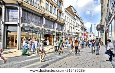 BRUSSELS, BELGIUM - SEPTEMBER 20, 2014:  a crowded 'Rue Neuve - Nieuwstraat' shopping street in Brussels, Belgium during a summer saturday.  20 September 2014 in Brussels. - stock photo