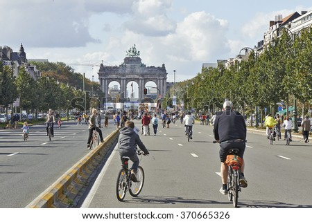 BRUSSELS, BELGIUM - SEPTEMBER 21, 2014:Bicyclist and walkers enjoy Car Free Streets on Tervueren Ave as part of Brussels City's Summer Streets September 21, 2014 in Brussels, Belgium - stock photo