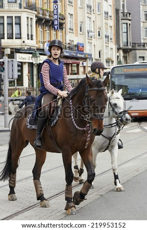 BRUSSELS, BELGIUM - SEPTEMBER 21, 2014:Bicyclist, joggers,skateboarder,horses and walkers enjoy Car Free Streets on Tervueren Ave as part of Brussels September 21, 2014 in Brussels, Belgium