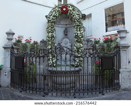 BRUSSELS, BELGIUM - SEPTEMBER 4: The famous Manneken Pis, the iconic statue of Brussels on September 4, 2014 in Brussels - stock photo