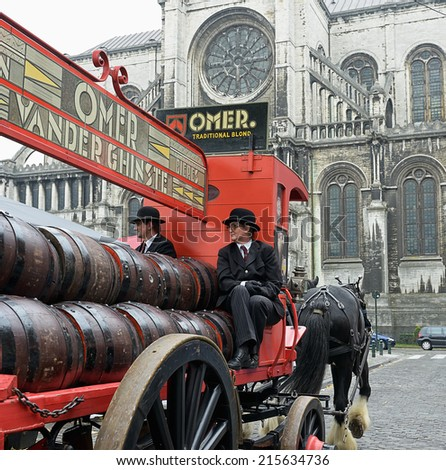 BRUSSELS, BELGIUM-SEPTEMBER 06, 2014: Vintage carriage of Omer beer manufacturer participates in parade dedicated to Belgian Beer Weekend. - stock photo