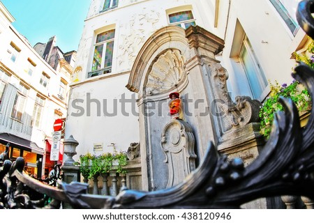 Brussels (Bruxelles), Belgium - May 07, 2016 - Mannekin Pis or le Petit Julien, the famous statue of little boy urinating into a fountain's basin designed by Hieronymus Duquesnoy the Elder - stock photo