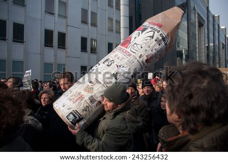 BRUSSELS - JANUARY 11: Silent march in support of free speech and against hate on January 11th, 2015 in Brussels, Belgium. 20000 persons participated. - stock photo