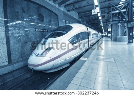 BRUSSELS - JULY 19: German ICE-train at Brussels train station on July 19, 2015 in Brussels, Belgium. ICE is Germany's flagship high speed train with possible maximum speed of over 400 km per hour. - stock photo