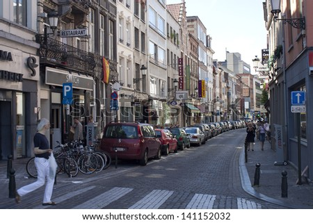 BRUSSELS - JULY 17: Unidentified people walk on a street on July 17, 2010 in Brussels, Belgium. Brussels is the capital of Belgium and the de facto capital of the European Union.