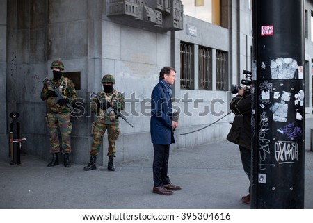 BRUSSELS - MARCH 23: Belgium Army secure the Central Station - Main Railway station of Brussels on March 23, 2016 in Brussels, Belgium, one day after the 2 terrorist attacks that hit the city.