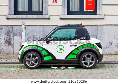 BRUSSELS - MARCH 14: Zen Car Europe's first electric car to rent on the square opposite the Luxembourg European Parliament March 14, 2012 in Brussels, Belgium - stock photo