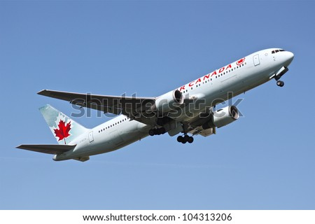 BRUSSELS - MAY 25: Boeing 767-375 of Air Canada approaching Brussels Airport in Brussels, BELGIUM on May 25, 2012. Air Canada is the flag carrier and largest airline of Canada. - stock photo