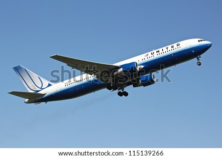 BRUSSELS - MAY 25: Boeing 777-222 of United Airlines approaching Brussels Airport in Brussels, BELGIUM on May 25, 2012. United Airlines is world's largest airline in terms of number of destinations. - stock photo