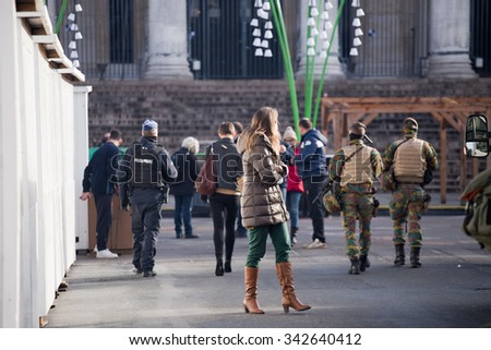 BRUSSELS - NOVEMBER 23: Belgium Army and police at the Bourse on the central avenue of Brussels as part of security lock-down following terrorist threats on November 23, 2015 in Brussels, Belgium.  - stock photo