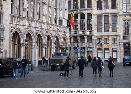 BRUSSELS - NOVEMBER 23: Belgium Army and police in Grand Place, the central square of Brussels as part of security lock-down following terrorist threats. on November 23, 2015 in Brussels, Belgium.  - stock photo