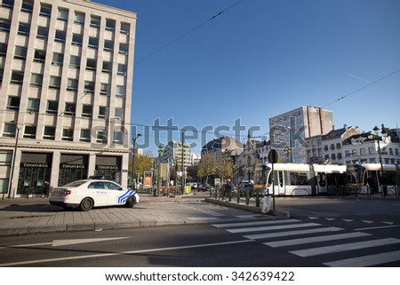 BRUSSELS - NOVEMBER 23: Belgium police securing Louise station in Brussels as part of security lock-down following terrorist threats on November 23, 2015 in Brussels, Belgium.  - stock photo