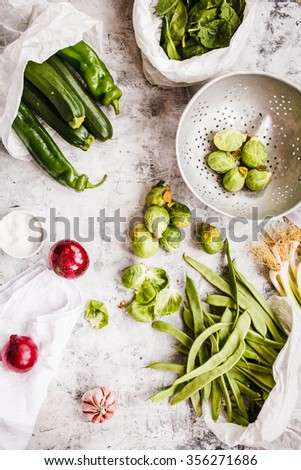 Brussels sprout and various green vegetables in white box over stone table. - stock photo
