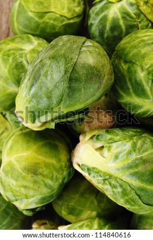 Brussels sprout on old wooden table - stock photo