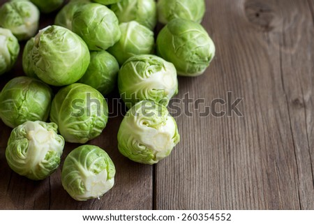 Brussels sprouts in a bowl on an old wooden table - stock photo