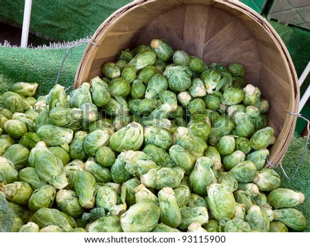 Brussels sprouts in bushel basket at farmers' market