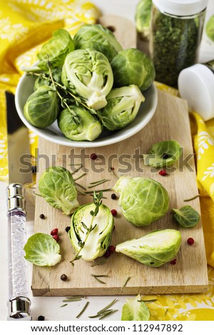 Brussels sprouts on a cutting board - stock photo
