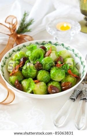 brussels sprouts with bacon and chestnuts for Christmas - stock photo