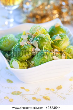 Brussels sprouts with flaked almonds and lemon zest for Christmas - stock photo