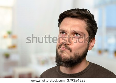Brutal bearded man thinking